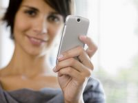 Businesswoman holding cell phone