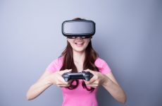 Happy woman playing games with the virtual reality headset, Asian beauty